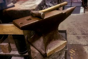 Anvil in copper sculptor workshop