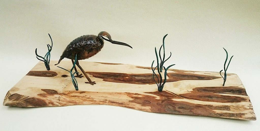 curlew on seashore sculpture