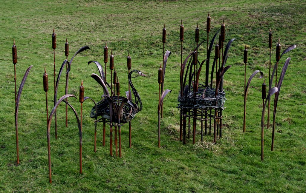 swan, nest and bulrushes sculpture group
