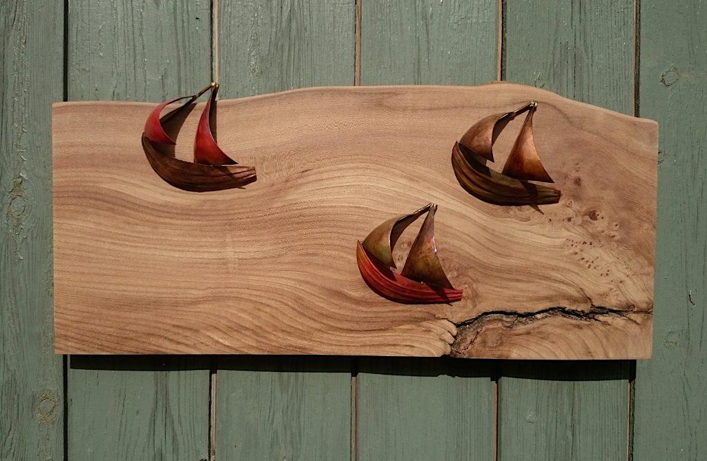 boat sculpture trio on elm