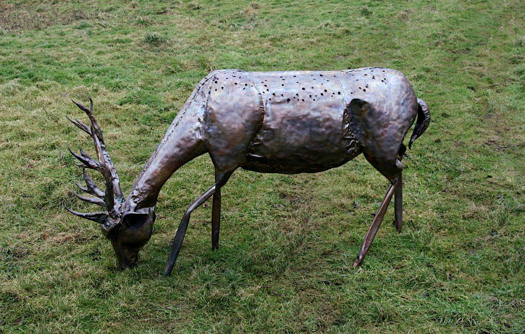 stag grazing sculpture