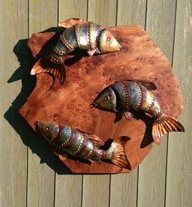fish trio on wood sculpture