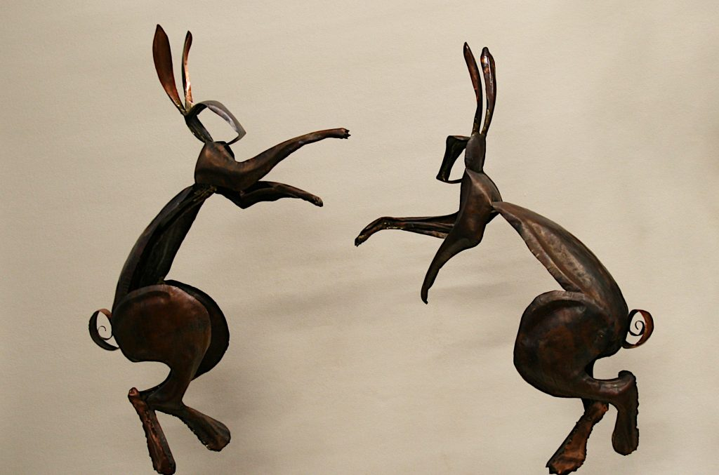 dancing boxing hares sculpture