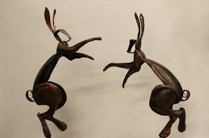 dancing boxing hares sculpture