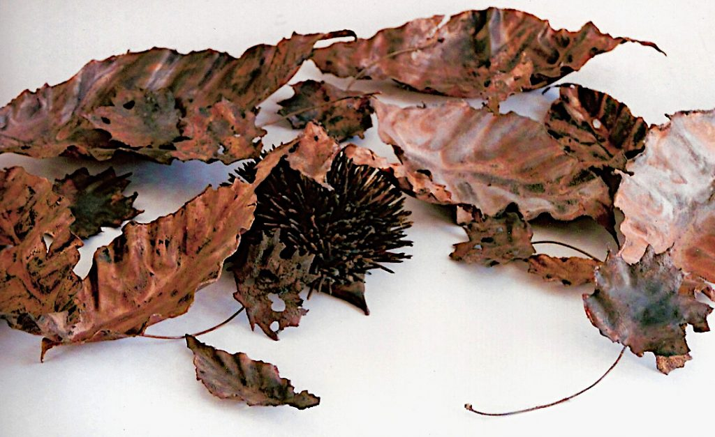 hedgehog in leaves sculpture