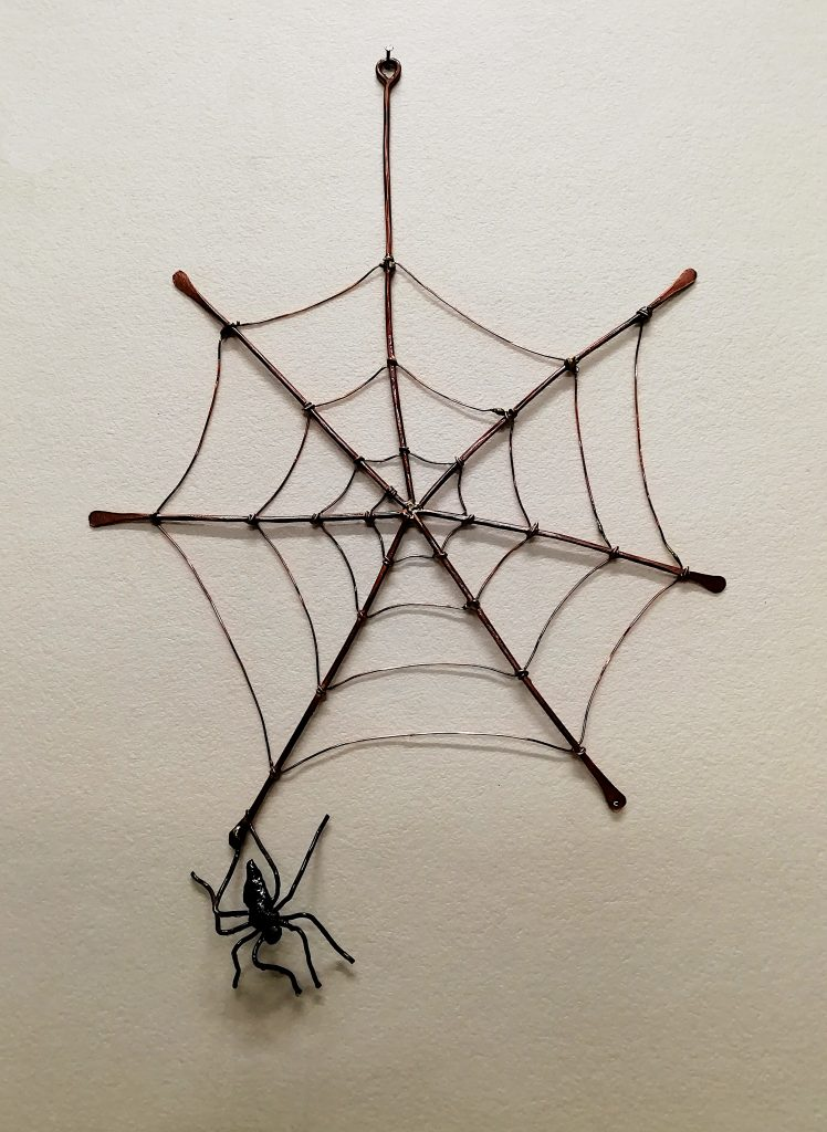 spider and web sculpture
