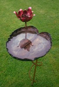 water-lily bird-bath sculpture